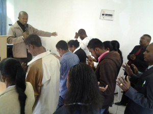 pastor Charles ministering healing in South Africa
